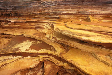 layer: Detailed view of a rock wall showing the geological sedimentary layers.