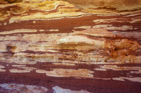 rock layers: Detailed view of a rock wall showing the geological sedimentary layers.