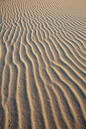 wind blown: Pattern of wind blown sand ripples reaching into the distance. Stock Photo