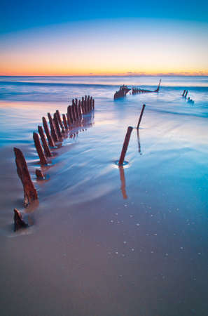 qld: The SS Dicky at sunrise. Shipwrecked on Dicky Beach, Queensland, Australia.
