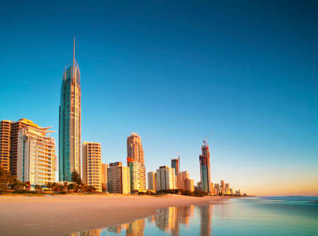 The buildings of Surfers Paradise, Queensland, Australia reflecting off the calm water in the early morning sunlight. Editorial