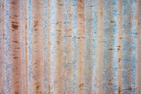 corrugation: Close up of an old, rusty piece of corrugated iron with vertical stripes.