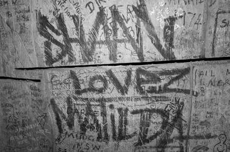 rebellious: Urban grunge graffiti tag. Black and white.