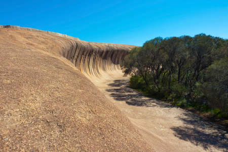 Wave Rock in Western Australia is a natural rock formation caused by wind erosion.