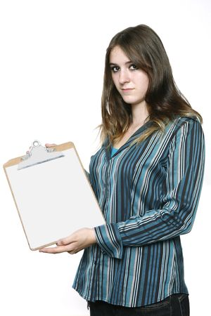 Teenage Girl holding a clipboard showing the Blank White Sheet. photo