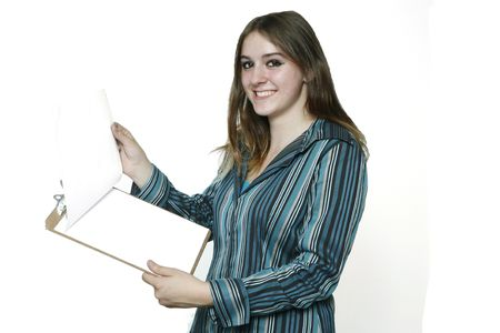 one sheet: Teenage Girl holding a clipboard showing the Blank White Sheet. Stock Photo