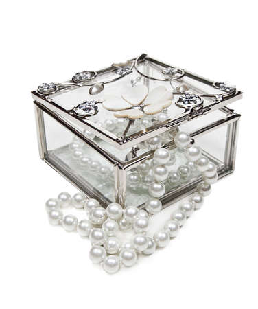 Glass jewelry box with pearls necklace isolated on white background photo