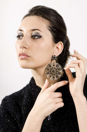 Portrait of beautiful woman with beautiful make-up and expensive earrings. photo