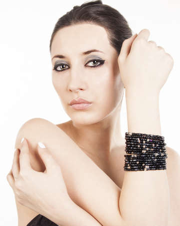 Young brunette lady with luxury black bracelet isolated on white background Stock Photo - 17282765