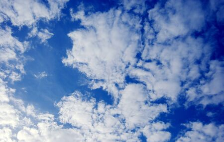 definite: white clouds and blue sky