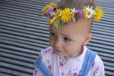 finesse: Portrait of little girl wearing a natural flower crown
