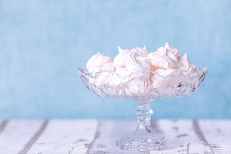 white tasty Meringe with blue background