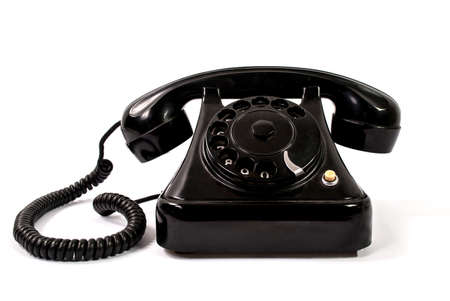 Old black phone isolated on a white background