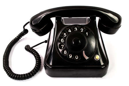 Old retro black phone isolated on a white background
