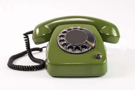 Old retro green phone on white background Stock Photo