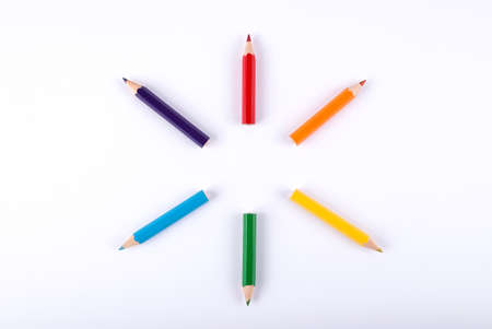 Colored wooden pencils arranged in the form of a circle
