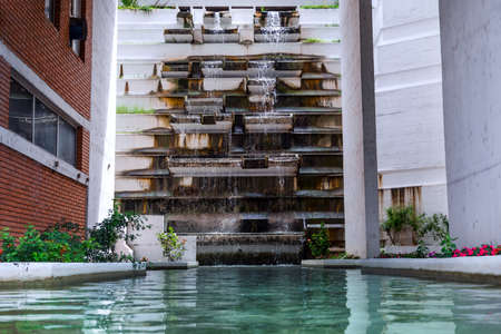 Spa healthy water and artificial waterfall building in resort. Source of healthy and healing water Stock Photo