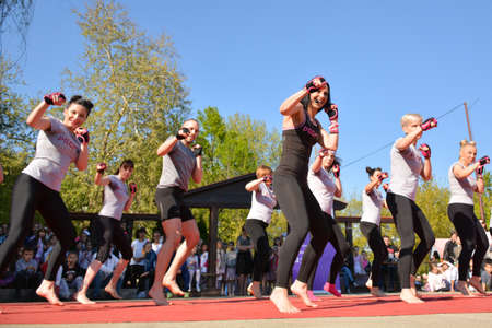 Nis, Serbia - April 20, 2019 Group of young people practicing Piloxing outside in park on sunny day on April 20, 2019 in park Sveti Sava, Nis, Serbia, Europe