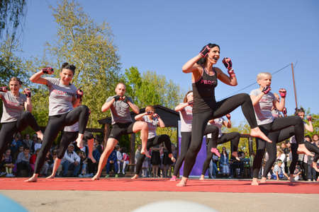 Nis, Serbia - April 20, 2019 Piloxing sport training big group of people on sunny spring day outdoor with instructor on April 20, 2019 in park Sveti Sava, Nis, Serbia, Europe