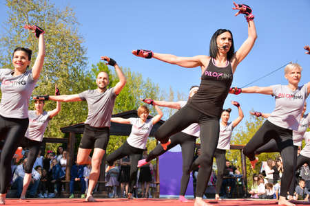 Nis, Serbia - April 20, 2019 Group of people participating in the free public Piloxing class in summer at park on sunny spring day on April 20, 2019 in park Sveti Sava, Nis, Serbia, Europe