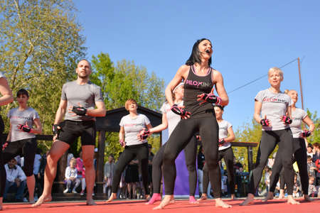 Nis, Serbia - April 20, 2019 Group of people practicing Piloxing sport in an outdoor class in summer with instructor on April 20, 2019 in park Sveti Sava, Nis, Serbia, Europe Editöryel