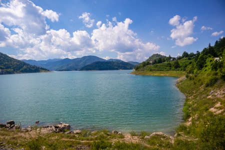Zaovine lake on Tara national park in Serbia, Europe. Beautiful landscape with dramatic sky, hills, and mountains. Tourism and travel concept