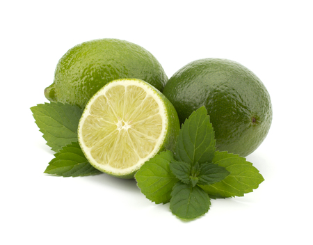 mint leaves: Fresh lime fruit with mint leaves isolated on white background