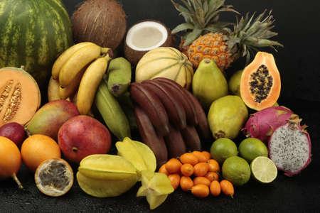 Exotic fruit arrangement on black background photo