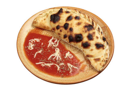 Studio shot of pizza Calzone isolated on white photo