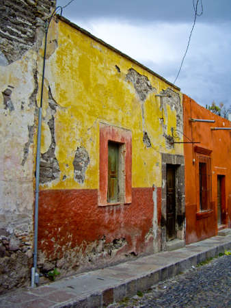Old Mexican houses on cobblestone street Stock Photo
