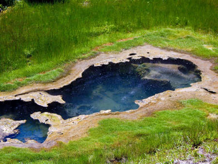 Geothermal pool among reeds at Yellowstone Stock Photo - 6744616