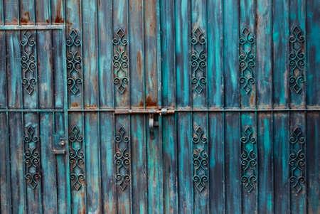 Rusted blue iron gateway with door Stock fotó