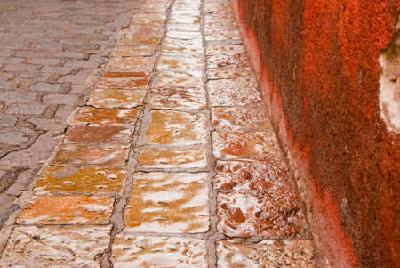 Color stone street after the rain in historic San Miguel de Alende Mexico photo