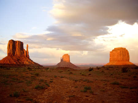 Sunset lights up the rock formations at Monument Valley
