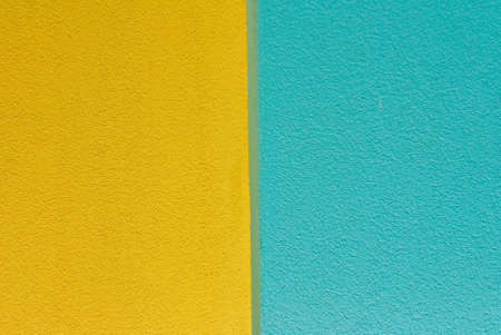 Wall of blue and yellow textured paint