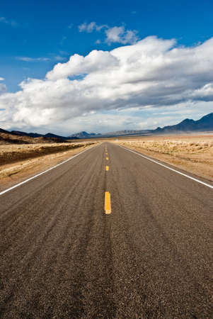 Road through desert in winter storm Stock fotó