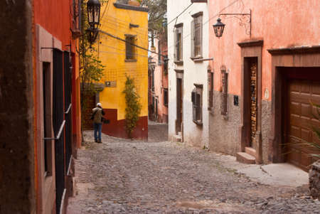 Photographer on side street in Mexico Stock Photo - 13315548