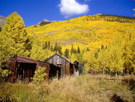 Old Silver Mining Cabins in Fall colors of Colorado USA