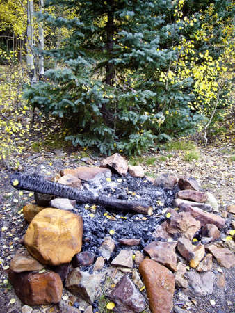 Campfire in Colorado high country forest in Fall