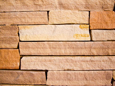 Colorful sandstone wall of yellow and orange