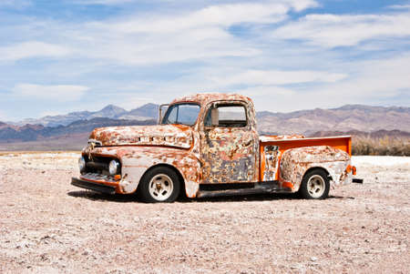 Abandoned vintage truck suffers in the hot desert