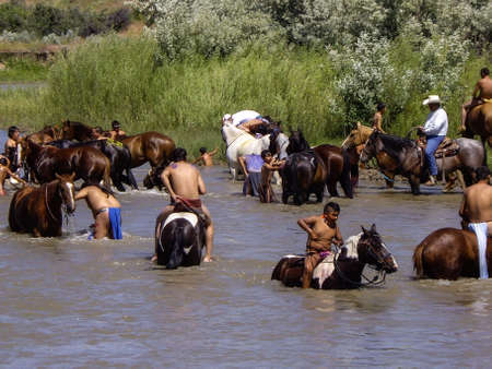 cool off: Indian warriors cool off in rivee after the reenactment of the battle Editorial