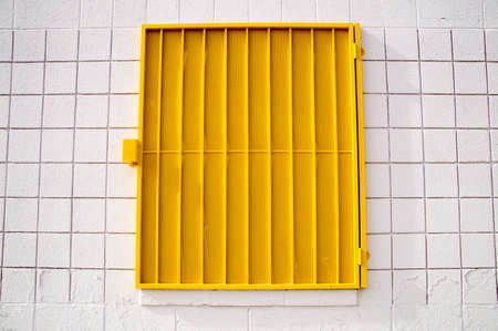 shutter: Urban design yellow shutter on white wall