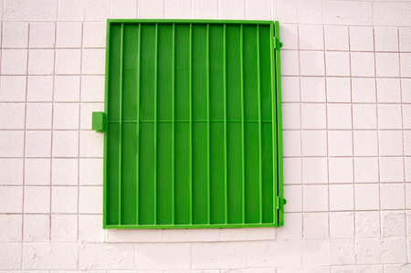 shutter: Urban design green shutter on white wall
