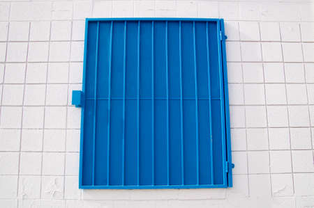 shutter: Urban design blue shutter on white wall
