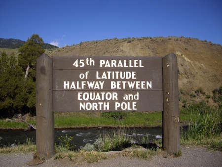 equator: 45th parallel of Latitude sign in Yellowstone Park, halfway between Equator and North Pole