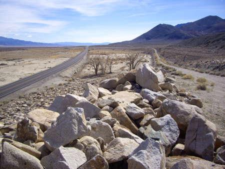 nevada desert: Long road through California desert of Sierra Nevada Stock Photo