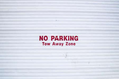 No Parking sign on corrugated metal doorway
