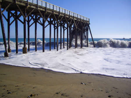 Wooden pier with high waves in California