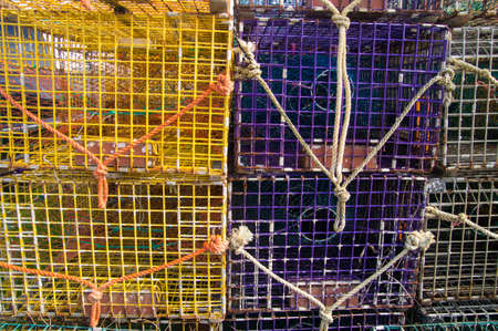 Colorful lobster pots on shore at Maine USA
